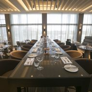 Long dining table with utensils