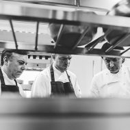 Novelli and other chefs look through his cooking
