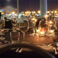Restaurant's utensils with city lights view